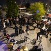 People watch as Ugly Boy, a band from east Las Vegas, performs during First Friday in the Arts ...