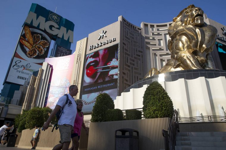 In this Aug. 4, 2021, file photo, visitors to the Las Vegas Strip pass MGM Grand. (Ellen Schmid ...
