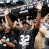 Fans, including Lorenzo Smith, right and patrick Manning, both of Oakland, cheer as the Raiders ...