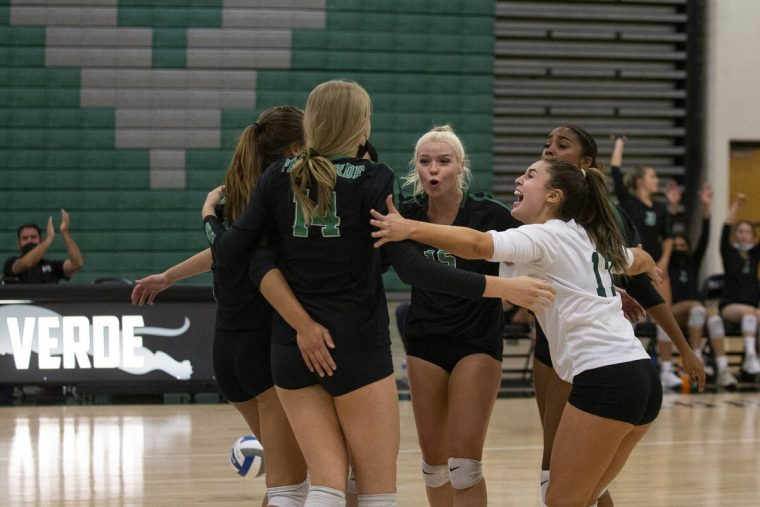 Palo Verde celebrates a point, including Kate Camp (14), Rilee Reed (15), center, and Brooke Pa ...