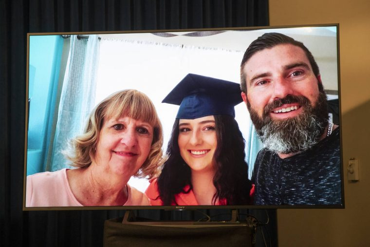 A photo of 17-year-old Mia Gugino, center, who died from a fentanyl overdose, is displayed in a ...