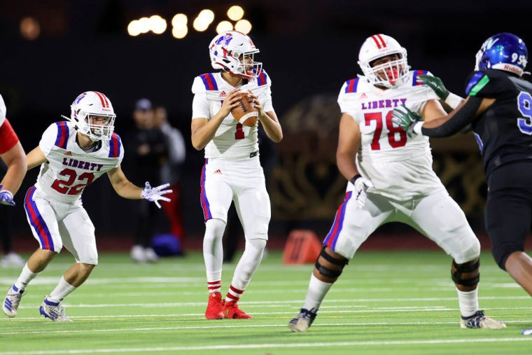 Liberty's Jayden Maiava (1) looks for an open pass in the first half of a football game against ...