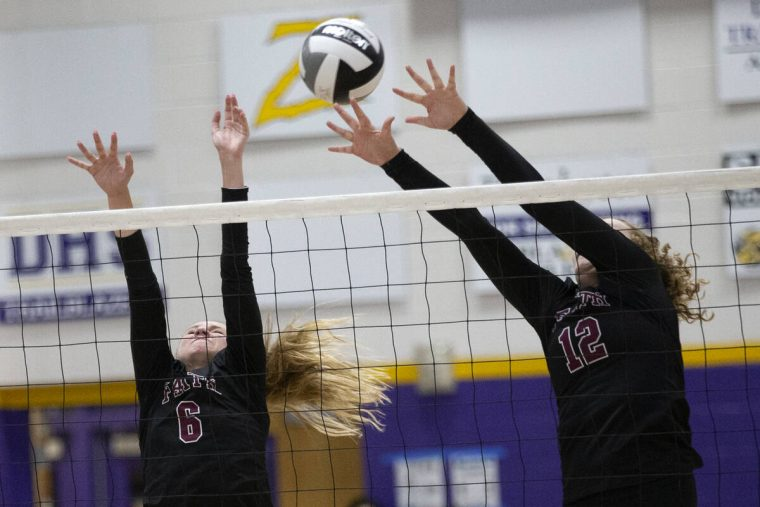 Faith Lutheran's Bianca Richardson (6) and Delaney Wilson (12) attempt to kill a Durango spike ...