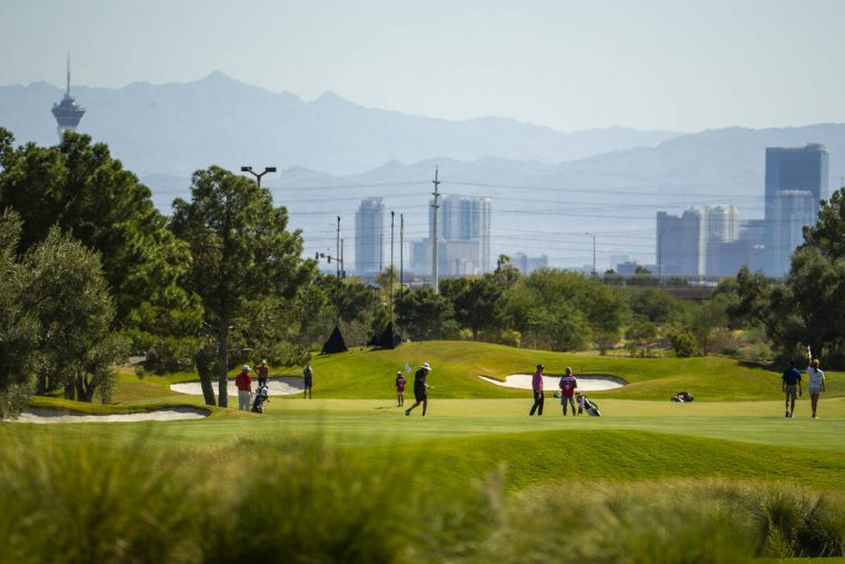 Golfers get a view of the city on the front nine during the final round of Shriners Hospitals f ...