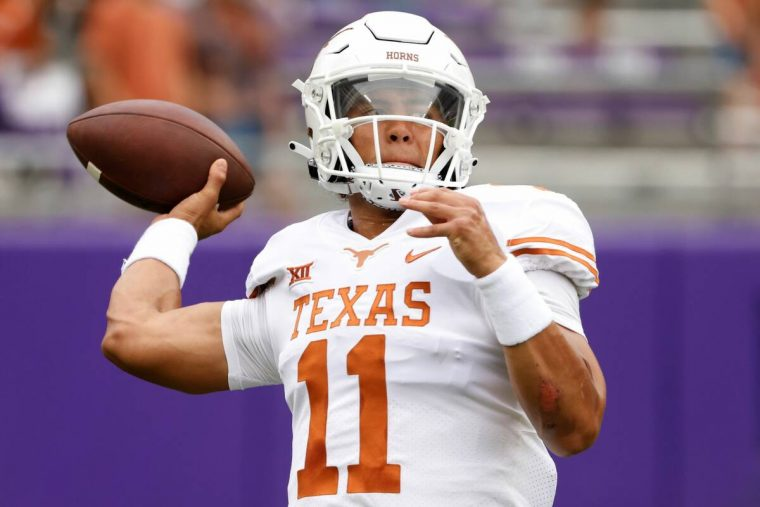 Texas quarterback Casey Thompson (11) warms up before playing TCU in an NCAA college football g ...