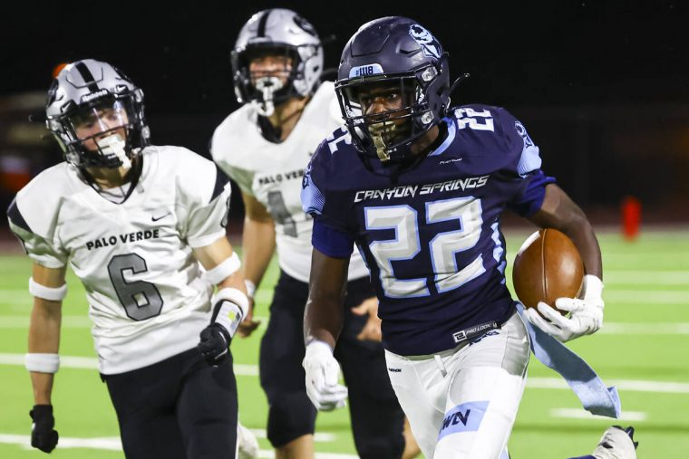 Canyon Springs' Omarion Ireland (22) runs the ball to score a touchdown against Palo Verde duri ...