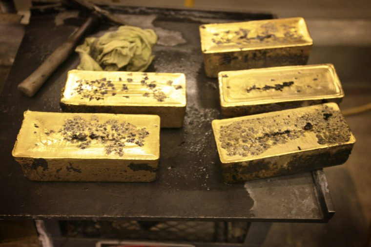 Sixty-pound bars of gold are seen at Barrick Gold Corp Pipeline refinery, located about 70 mile ...