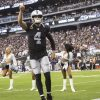 Raiders quarterback Derek Carr (4) salutes the crowd after being announced before the start of ...