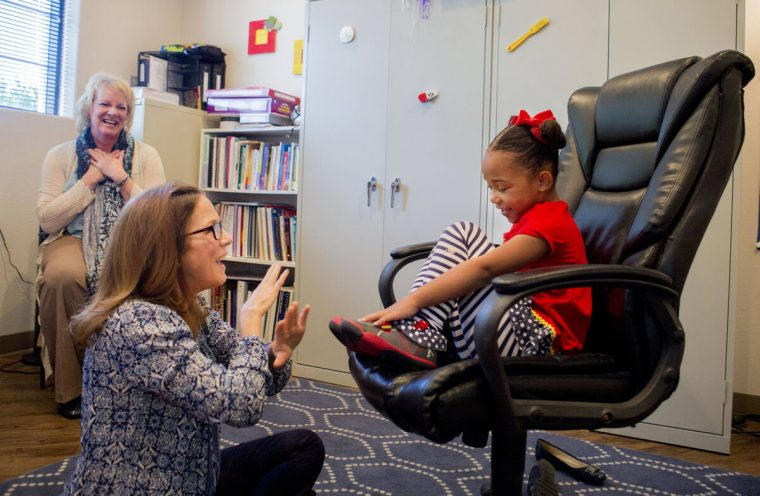 Client Hannah Beal, 4, and Julie Cole, a speech-language pathologist, engage in play therapy at ...