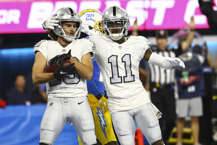 Raiders wide receiver Henry Ruggs III (11) celebrates a touchdown by wide receiver Hunter Renfr ...