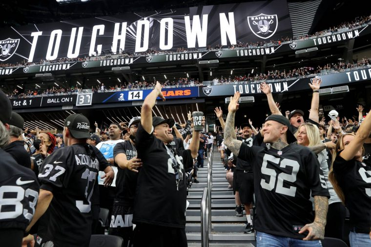 Fans, including Johnny Flores of Fontana, Calif., left, and Robert Pearlman of Newport Beach, c ...