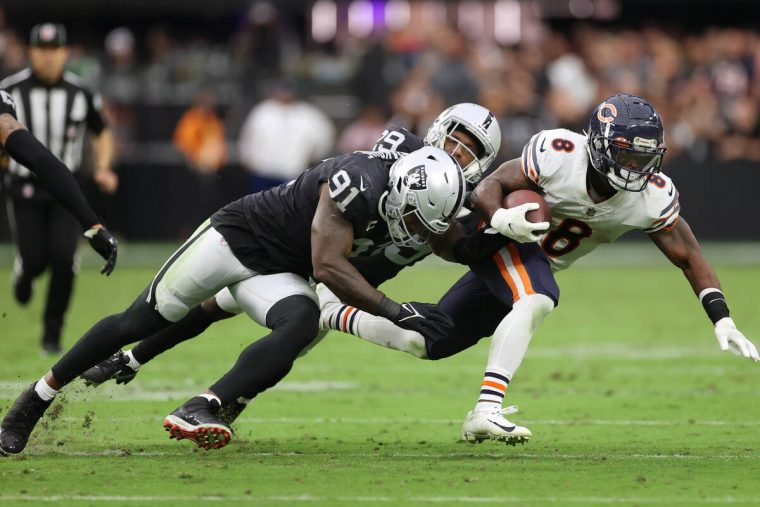 Chicago Bears running back Damien Williams (8) is tackled by Raiders defensive end Yannick Ngak ...