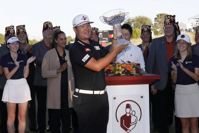 Sungjae Im holds up his trophy after he won the final round of the Shriners Hospitals for Child ...