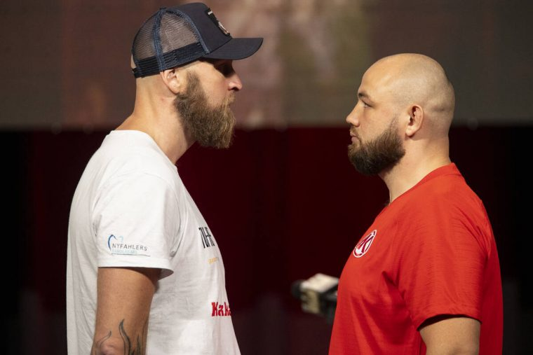 Robert Helenius, left, and Adam Kownacki, pose during a press conference at the MGM Grand Garde ...