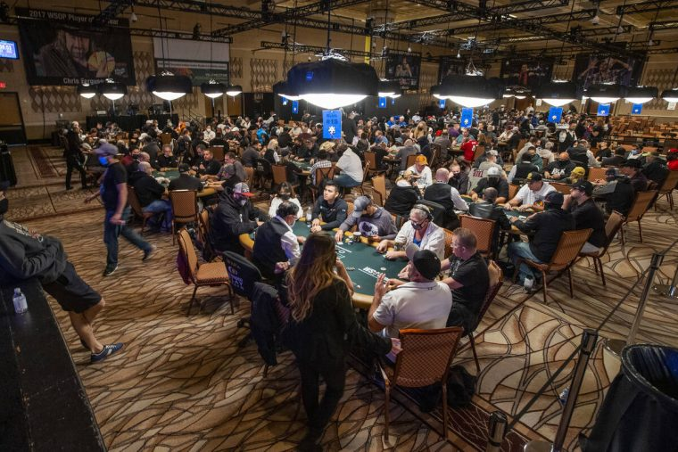 Players fill the room during a $500 casino employees event on the first day of the World Series ...